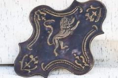 Placa bronce león